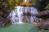Waterfall in deep rain forest jungle (Thung Nang Khruan Waterfall) Thailand