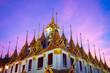 Leinwanddruck Bild Loha Prasart inside Wat Ratchanaddaram in Bangkok during sunset.