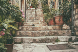 Fototapeta Fototapety na drzwi - Mediterranean summer cityscape - view of a medieval street with stairs in the Old Town of Dubrovnik on the Adriatic Sea coast of Croatia