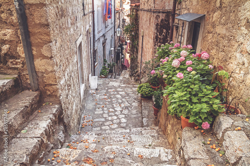 Fototapety, obrazy: Mediterranean summer cityscape - view of a medieval street with stairs in the Old Town of Dubrovnik on the Adriatic Sea coast of Croatia