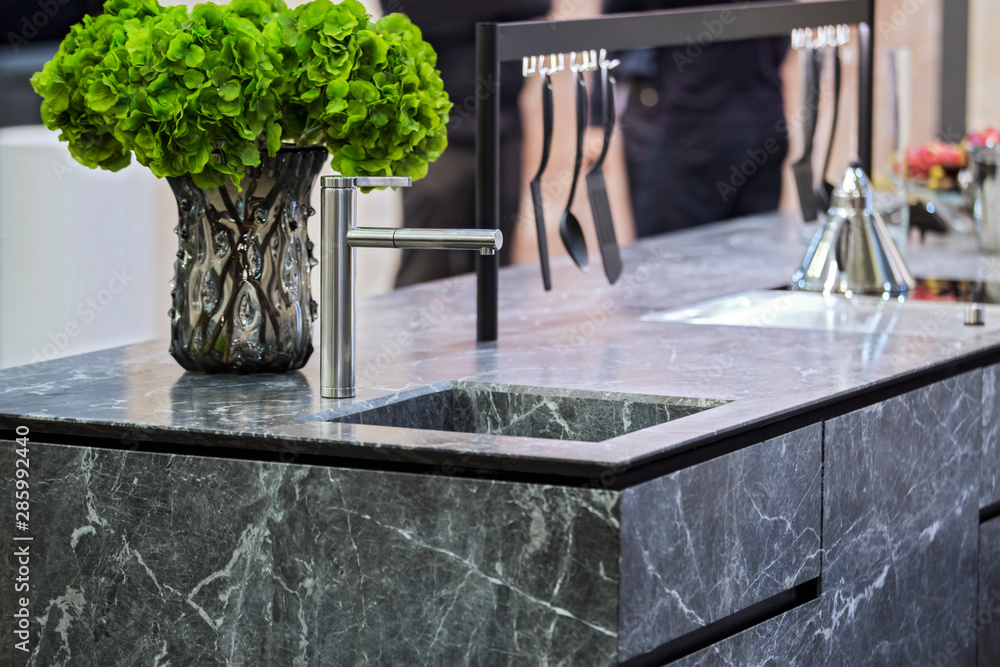 Fototapeta Beautiful modern kitchen design, kitchen faucet and kitchen decor, gray marble kitchen island
