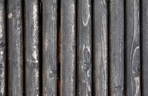 Black painted weathered wooden fence texture #285997063
