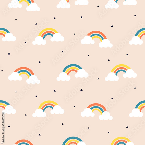 Cute rainbow and clouds beige seamless pattern.