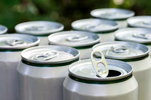 Open Close-up Of An Aluminum Can Of Beer On The Background Of A Group Of Closed Beer Cans