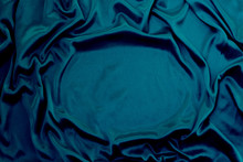 Photograph Of Silk Fabric, Color Blue. The Texture Of Silk Fabric. Luxury Silk Fabric Background With Waves And Drapery. Background For Fashion Luxury Design, Close-up, Copy Space