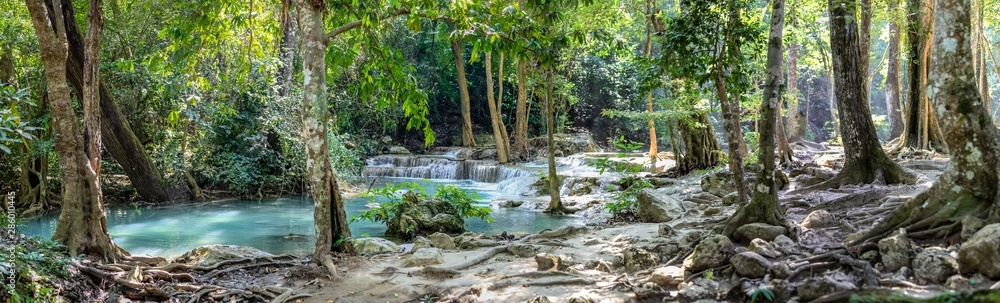 Fototapety, obrazy: Panorama of bare tree roots and a series of beautiful short waterfalls in the dense forest of Erawan National park in Thailand