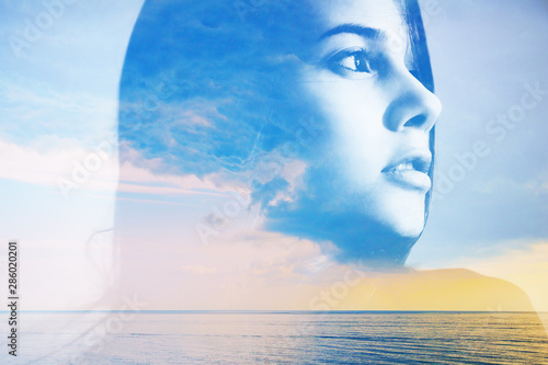 Photo sur Toile Les Textures Double multiply exposure abstract portrait of a dreamy cute young woman head silhouette in clouds and sky, sunrise or sunset nature. Psychology power of mind, human spirit, mental health, zen concept.