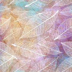 FototapetaAutumnal skeleton leaves seamless pattern on a grunge artistic background.