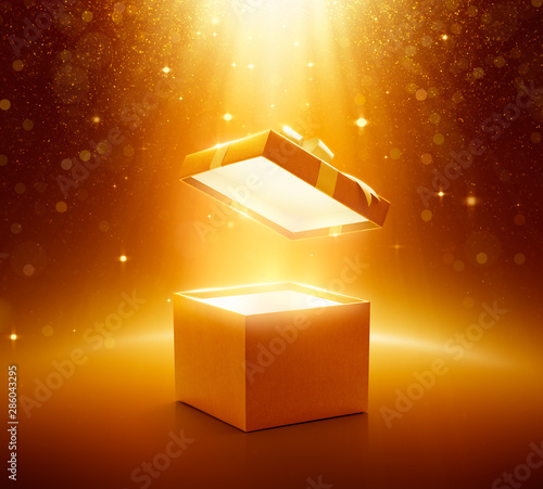 Gold open gift box on glittering background Wall mural