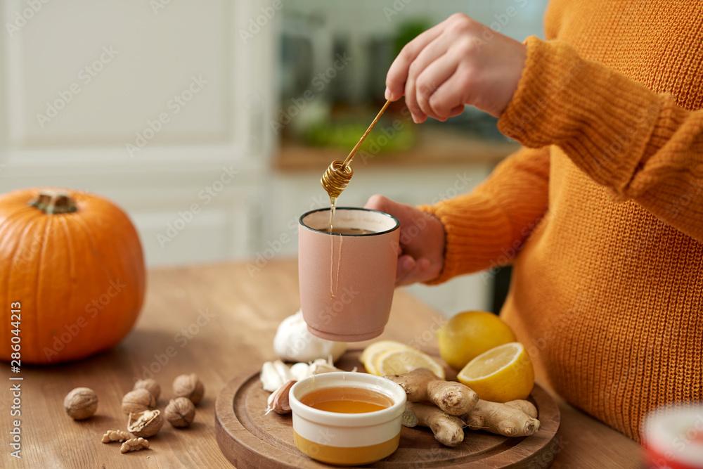Fototapety, obrazy: Woman making hot tea with honey