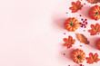 canvas print picture Autumn composition. Dried leaves, pumpkins, flowers, rowan berries on pink background. Autumn, fall, halloween, thanksgiving day concept. Flat lay, top view, copy space