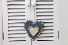 Grey Wood Heart Hanging On Shutter