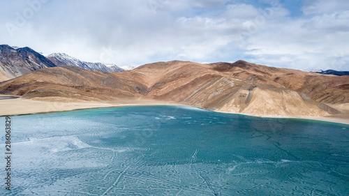 Blue Ice surface of Frozen Lake from drone aerial view at Pangong Lake or Pangong Tso, Tso moriri – Nubra, India Wallpaper Mural