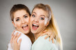 canvas print picture - Two happy friends women hugging