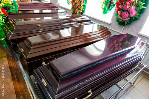 Fototapeta Shop selling coffins and funeral wreaths