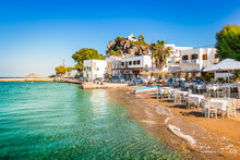 Patmos Island, Greece. Skala Village And Harbor View With Beach At The Port.