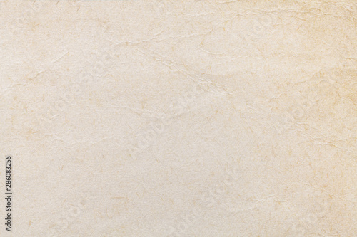 Texture of beige old paper, crumpled background. Vintage white grunge surface backdrop.