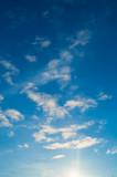 Fototapeta Na sufit - Blue sky background. Clouds lit by sunlight, blue sky view