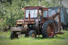 Rusty Old Tractor In A Field