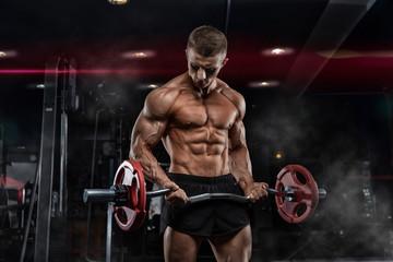 oung adult bodybuilder doin...