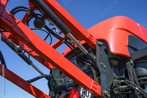 Fototapeta Hydraulic system, steel tubes, industrial tools equipment on agricultural machinery tractor or harvester obraz