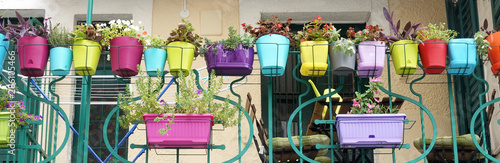 Fotografiet Colorful flowers and flowerpots variety beautiful terrace balcony house exterior