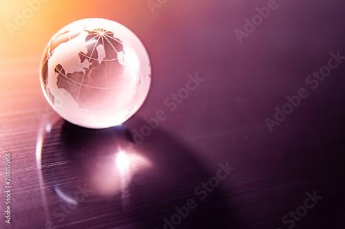 Cuadros en Lienzo  World globe crystal glass reflect on glossy table