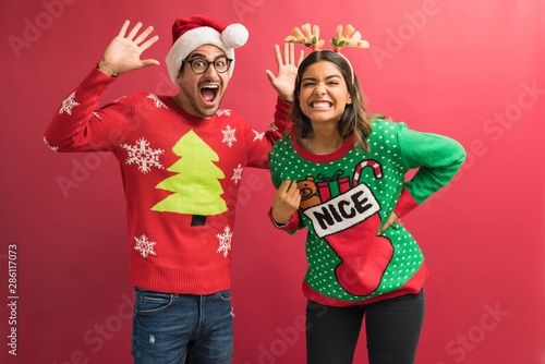 Lovely Couple In Ugly Sweaters During Christmas