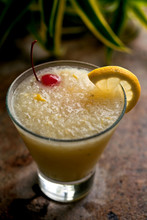 Close Up Of Frozen Lemon Crush Cocktail Served In Glass