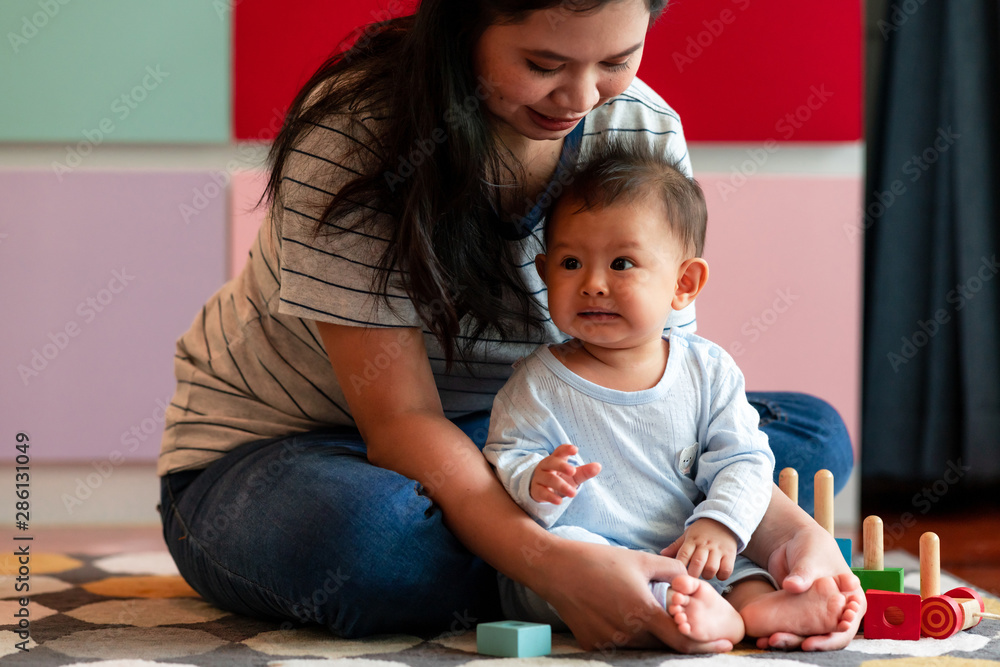 Fototapety, obrazy: Young asian mother playing with her male toddler in living room. Happy smile.