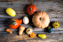 Overhead View Of Gourds On Wooden Table