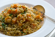 Close Up Of Risotto With Roasted Winter Squash Served On Plate