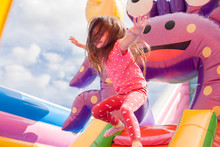 A Cheerful Child Plays In An I...