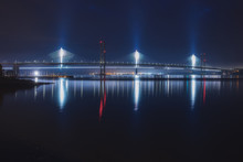 Night View Of Two Bridges Over The Sea Bay, Forth Road Bridge And Queensferry Crossing, Scotland, United Kingdom