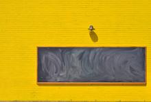 Black Board On Yellow Brick Wall