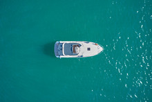 White Yacht On Blue Water Top View