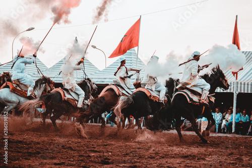 Tbourida Fantasia Morocco inezgane festival kssima knights on horses show with a Canvas Print