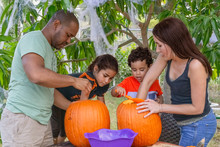 Halloween Pumpkin Carving Is A Family Tradition Working Closely Together. Outdoors Is The Perfect Spot To Make A Mess Creating A Jack O Lantern To Decorate.