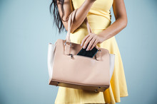 Woman Hand Phone With Bag In Studio