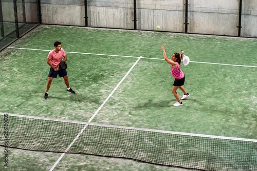 Cuadros en Lienzo mixed padel match in a padel court indoor