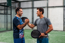 Two Padel Players Shaking Hands After Win A Padel Match