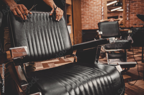 Barbershop armchair. Modern hairdresser and hair salon, barber shop for men