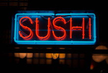 Neon Sushi Sign Outside Of A R...