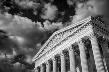 Dramatic Black And White View Of The Neoclassical Facade Of The Supreme Court Of The United States In Washington DC, USA