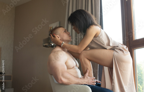 fototapeta na lodówkę Multiracial couple in sensual erotic foreplay.