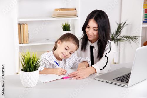 Cuadros en Lienzo  Home tutor concept. Doing homework together