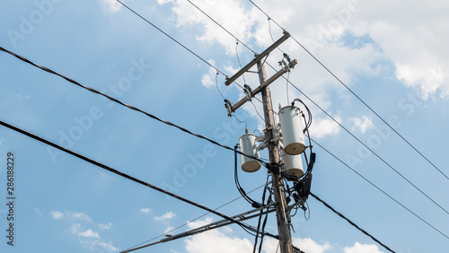 Fényképezés Power line pole with a transformer on it