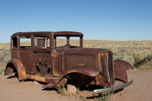 Old Rusted Car Body In Desert