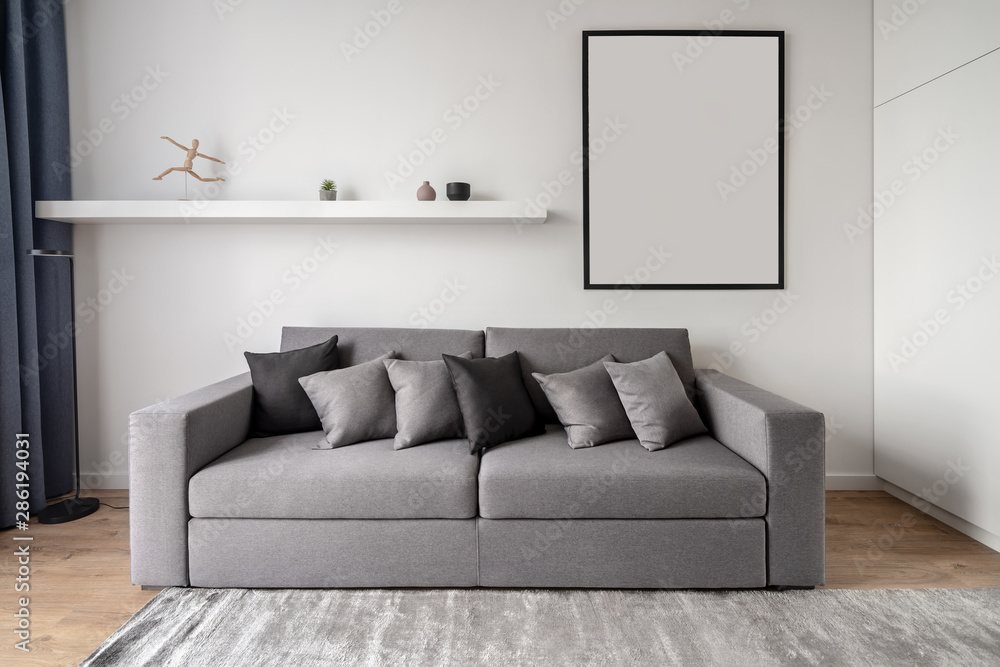 Fototapeta Stylish modern interior with white walls and parquet with carpet