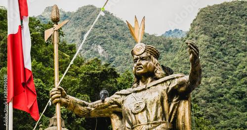 Fototapeta  Aguas Calientes, Peru - 05/21/2019: Statues of Inca Emperor Pachacuti in Aguas Calientes square in Peru outside Machu Picchu